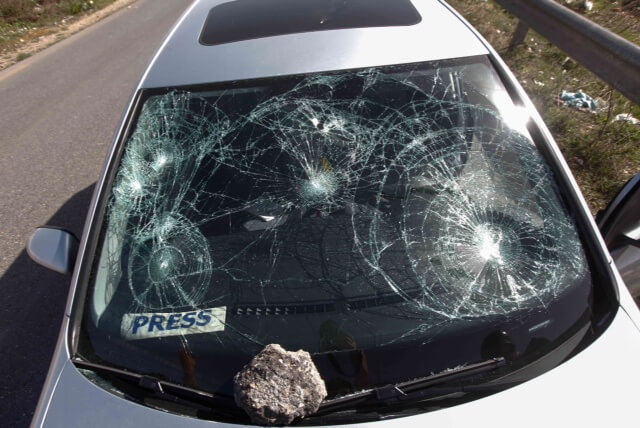 An AFP photographer's car after attack by West Bank settlers.